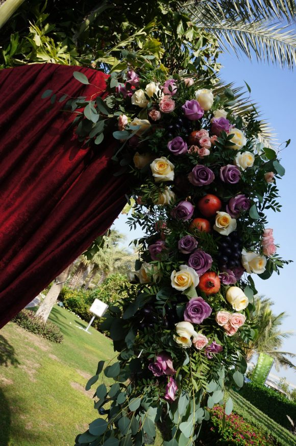 wedding arch with fruits and flowers