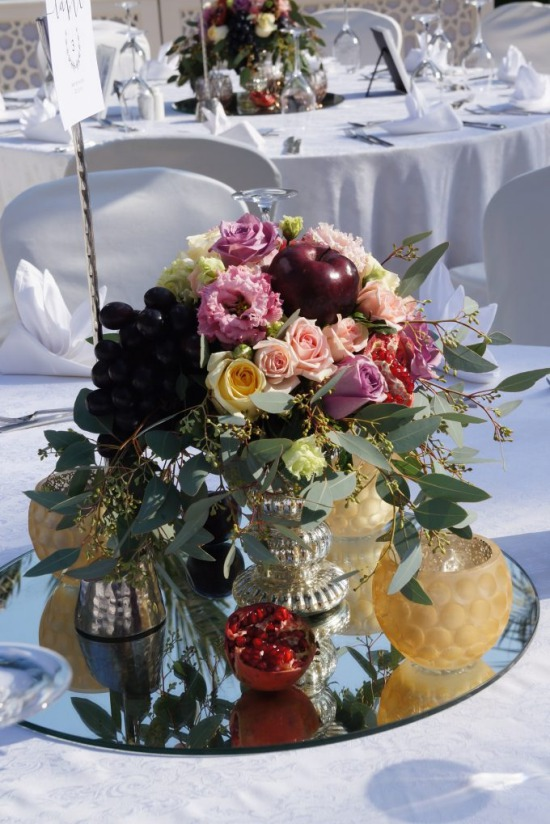 table centerpiece with flowers and fruits